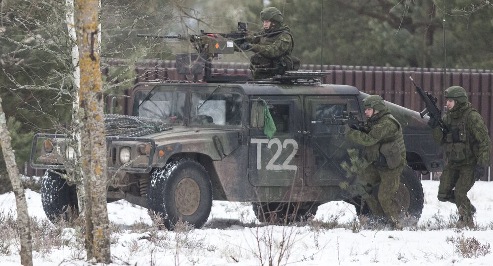 Soldiers take part in the NATO military exercise 'Iron Sword 2016' at a training range in Pabrade, north of the capital Vilnius, Lithuania on Friday, Dec. 2, 2016. The US and NATO have beefed up their presence throughout Eastern Europe significantly over the past two years following the outbreak of the crisis in Ukraine.