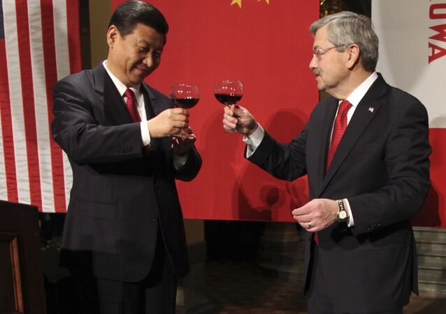 Chinese Vice President Xi Jinping, left, and Iowa Gov. Terry Branstad raise their glasses at the beginning of a formal dinner in the rotunda at the Iowa Statehouse, Wednesday, Feb. 15, 2012, in Des Moines, Iowa.