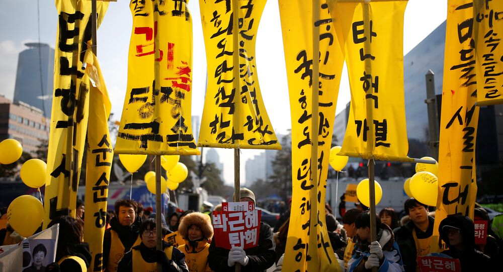 Protesters attend a rally demanding the impeachment of South Korean President Park Geun-hye in front of the National Assembly in Seoul, South Korea, December 9, 2016. The sign reads Impeach Park Geun-hye.