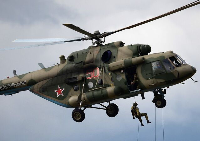 A landing party from an MI-8 helicopter