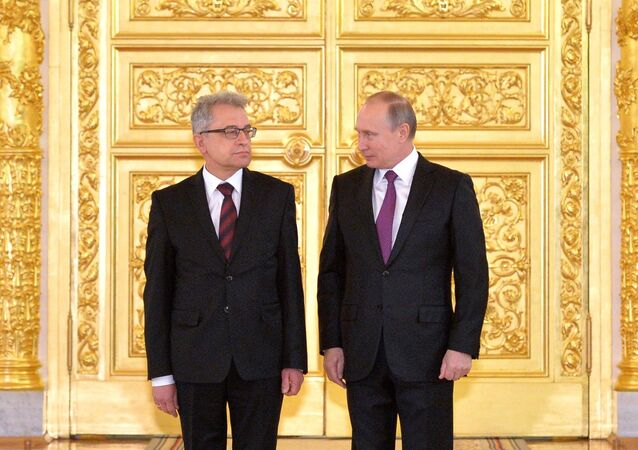 Russian President Vladimir Putin and Ambassador Extraordinary and Plenipotentiary of the Republic of Poland to Russia Wlodzimierz Aleksander Marciniak, left
