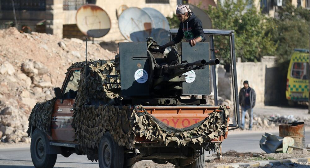 A rebel fighter stands on a pick-up truck mounted with a weapon in a rebel-held area of Aleppo, Syria December 9, 2016