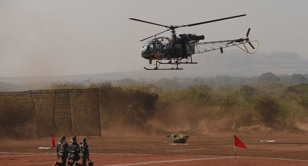 Indian soldiers watch as a 120mm Brandt Mortar is lowered from a Cheetah helicopter (File)