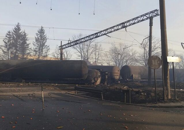 In this photo released by Bulgarian Interior Ministry, burned containers are seen derailed after an explosion upon derailment in the village of Hitrino in Bulgaria Saturday, Dec 10, 2016