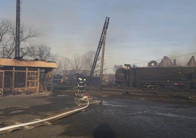 In this photo released by Bulgarian Interior Ministry, firefighters work at the scene of a train derailment following an explosion in the village of Hitrino in Bulgaria Saturday, Dec 10, 2016