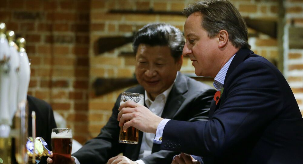 Then Britain's Prime Minister David Cameron, right, drinks a pint of beer with Chinese President Xi Jinping, at The Plough pub in Casden, England on October 22, 2015.