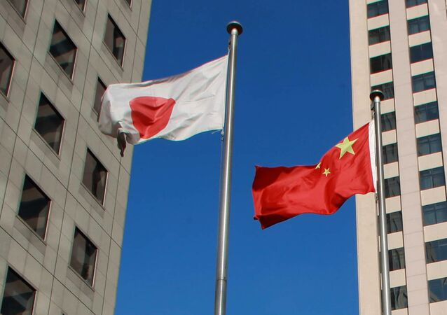 Chinese national flag (C) and a Japanese national flag (L) (File)