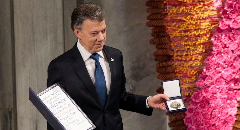 Nobel Peace Prize laureate Colombian President Juan Manuel Santos poses with the medal and diploma during the Peace Prize awarding ceremony at the City Hall in Oslo, Norway December 10, 2016