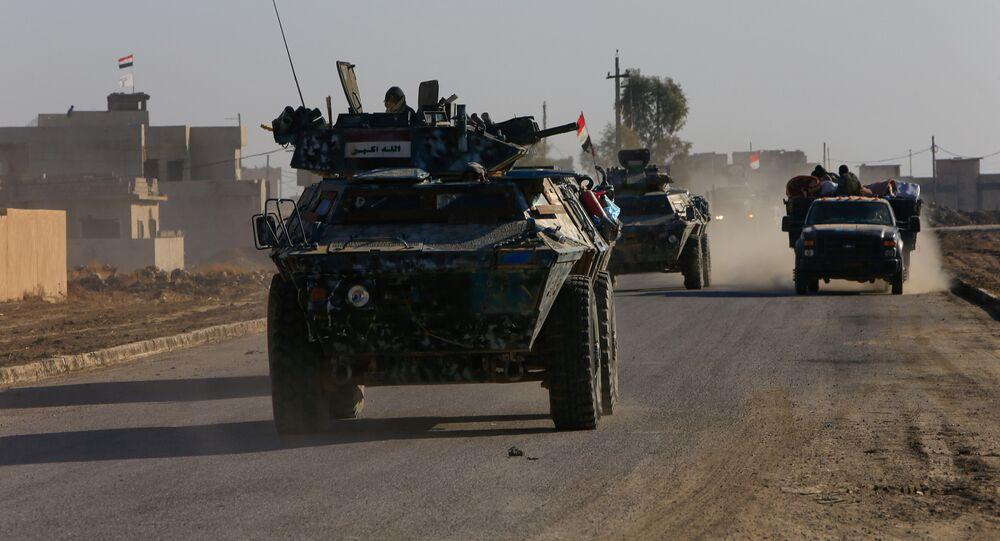 Iraqi security forces members drive a military vehicle in Qaraqosh, near Mosul, Iraq December 9, 2016