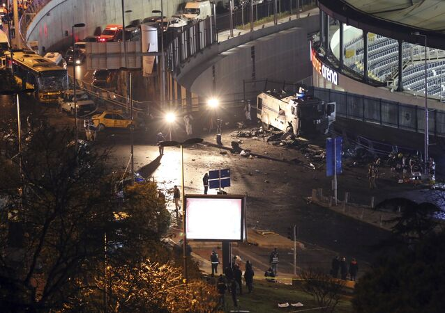 Rescue services work at the scene of explosions near the Besiktas football club stadium after attacks in Istanbul, late Saturday, Dec. 10, 2016. Two explosions struck Saturday night outside a major soccer stadium in Istanbul after fans had gone home, an attack that wounded about 20 police officers, Turkish authorities said. Turkish authorities have banned distribution of images relating to the Istanbul explosions within Turkey.