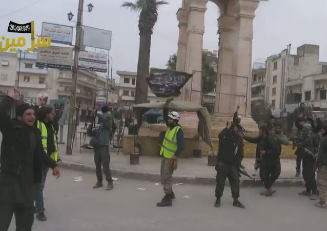 White Helmets, seen here celebrating with Nusra extremists