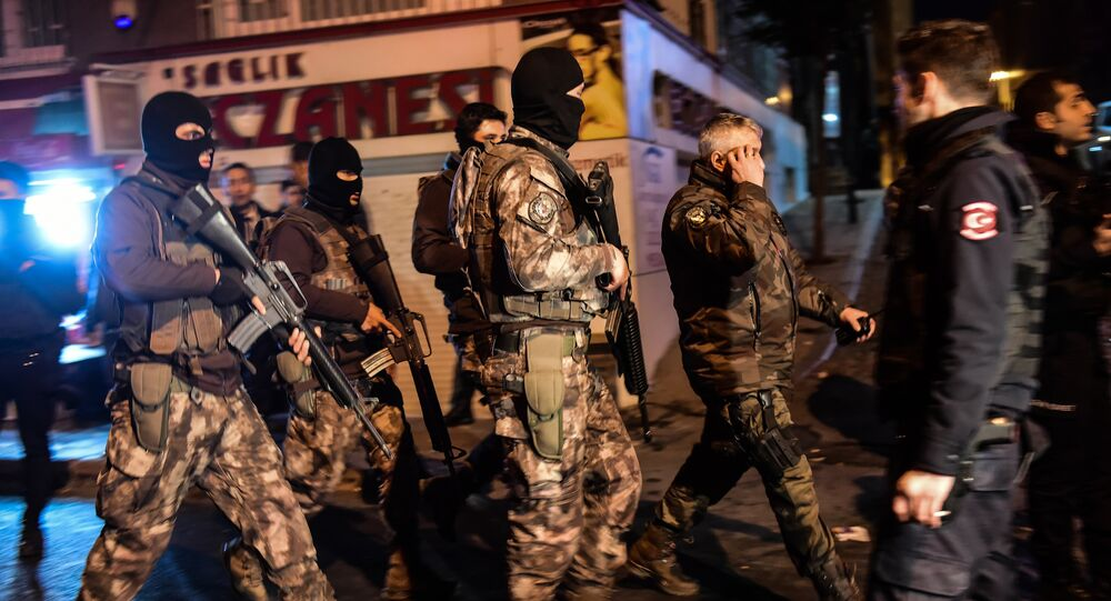 Turkish special force police officers patrol streets after a car bomb exploded near the stadium of football club Besiktas in Istanbul on December 10, 2016