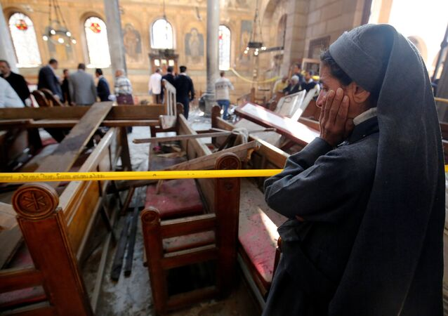A nun cries as she stands at the scene inside Cairo's Coptic cathedral, following a bombing, in Egypt December 11, 2016
