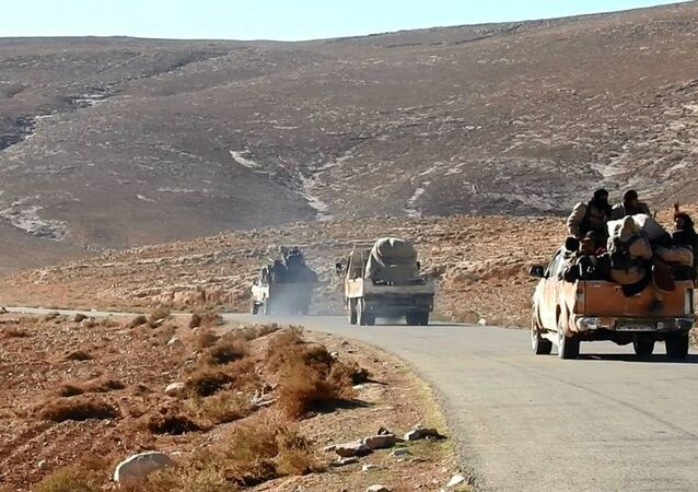 This image posted online by Daesh supporters  on an anonymous photo sharing website, purports to show a convoy of Daesh vehicles driving in a desert area of east of Palmyra city, in Homs, Syria