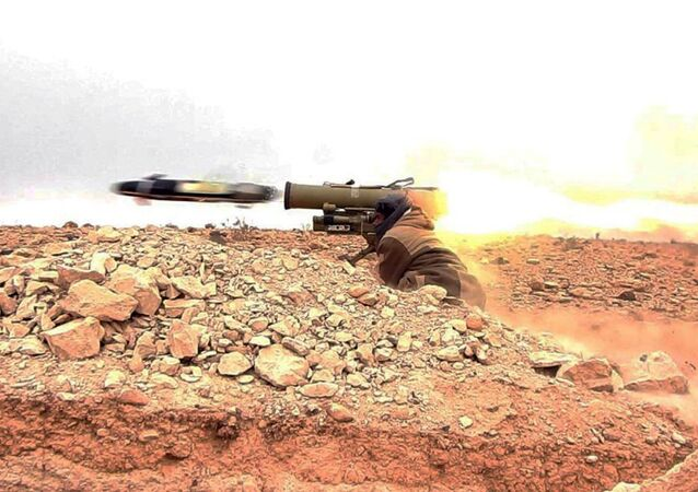 Daesh gunman firing an anti-tank missile at Syrian troops north of Palmyra city, in Homs Provence, Syria (File)