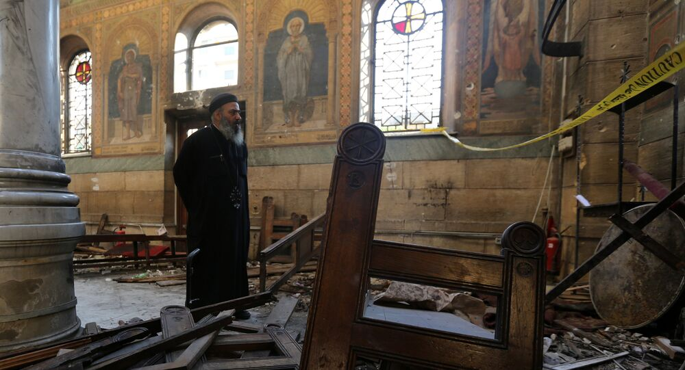 A Coptic priest stands at the scene following a bombing inside Cairo's Coptic cathedral in Egypt December 11, 2016