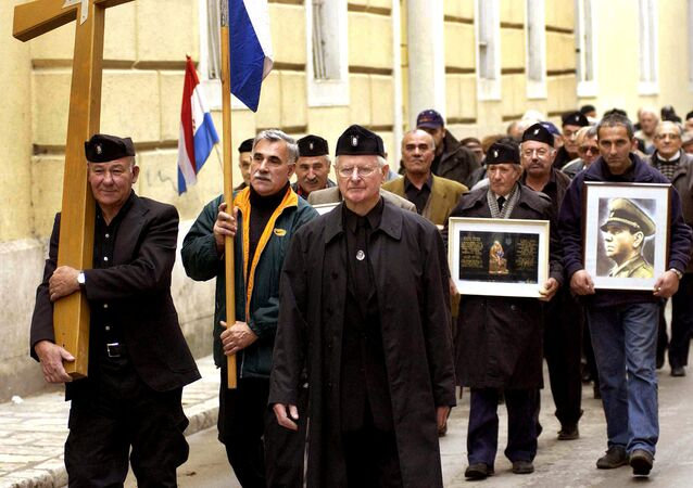 A group of mostly older Croatians, wearing Second World War Ustasha regime uniforms, parade in the Croatian Adriatic resort of Zadar, carrying a portrait of the late Ustasha leader, Ante Pavelic (R), 07 December 2004