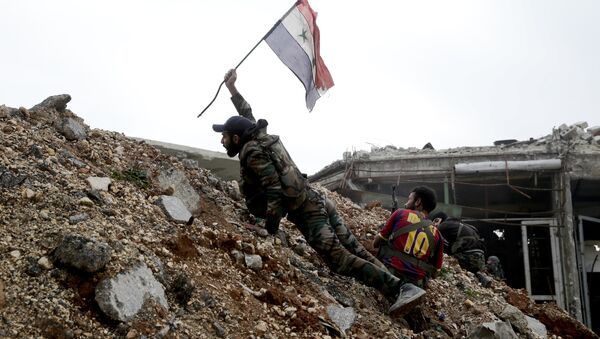 Syrian army soldier places a Syrian national flag during a battle with rebel fighters at the Ramouseh front line, east of Aleppo, Syria - Sputnik International