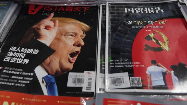 A magazine featuring US President-elect Donald Trump is seen at a bookstore in Beijing on December 12, 2016. The headline reads How will businessman Trump change the world - Sputnik International