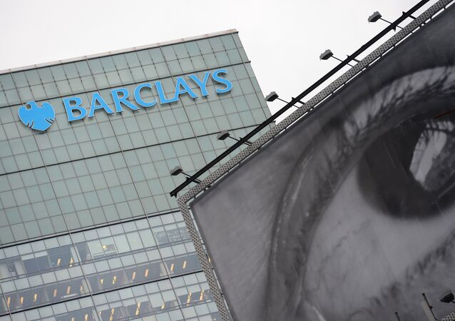 Barclays' bank logo is seen above a billboard displaying art photography in New York, June 11, 2013