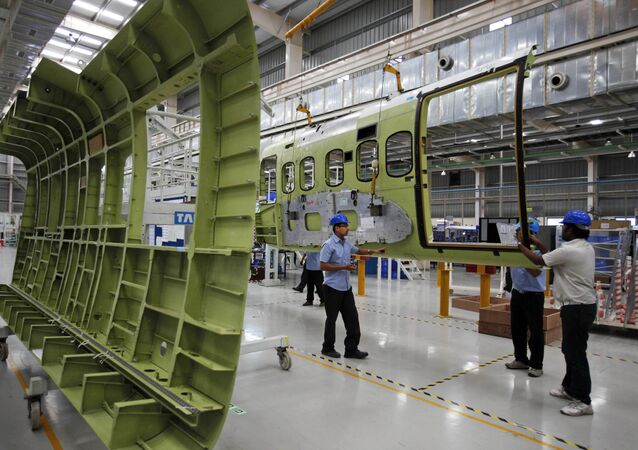 Indian workers assemble the cabin of a Sikorsky S-92 helicopter at a Tata Advanced Systems factory in Hyderabad, India, Monday, April 2, 2012