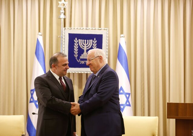 Israeli President Reuven Rivlin shakes hands with Turkish ambassador to Israel Kemal Okem during a ceremony of receiving diplomatic credentials at Rivlin official residence in Jerusalem December 12, 2016