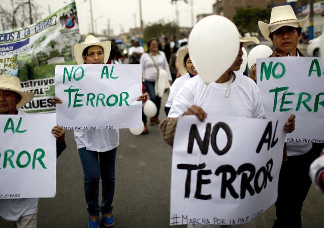 Women hold posters that read in Spanish No to terror during a march for peace and against terrorism in Comas district, Lima, Peru, on Thursday, Sept. 29, 2016