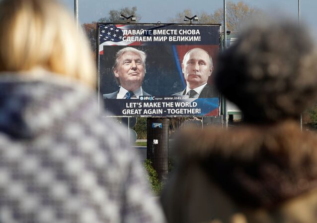 A billboard showing a pictures of US president-elect Donald Trump and Russian President Vladimir Putin is seen through pedesterians in Danilovgrad, Montenegro, November 16, 2016