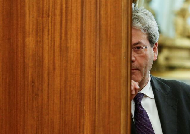 Italian Prime Minister-designate Paolo Gentiloni leaves at the end of a meeting at the Low Chamber in Rome, Italy December 12, 2016.