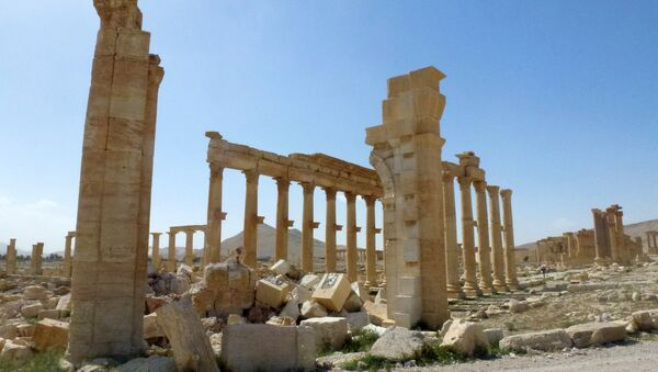 This file photo taken on March 27, 2016 shows a view of the remains of Arch of Triumph, also called the Monumental Arch of Palmyra, that was destroyed by Islamic State (IS) group jihadists in October 2015 in the ancient Syrian city of Palmyra - Sputnik International
