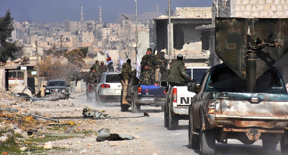 Syrian pro-government forces patrol Aleppo's Sheikh Saeed district, on December 12, 2016, after troops retook the area from rebel fighters