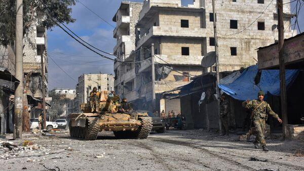 Syrian pro-government forces patrol Aleppo's eastern al-Salihin neighbourhood on December 12, 2016 after troops retook the area from rebel fighters - Sputnik International