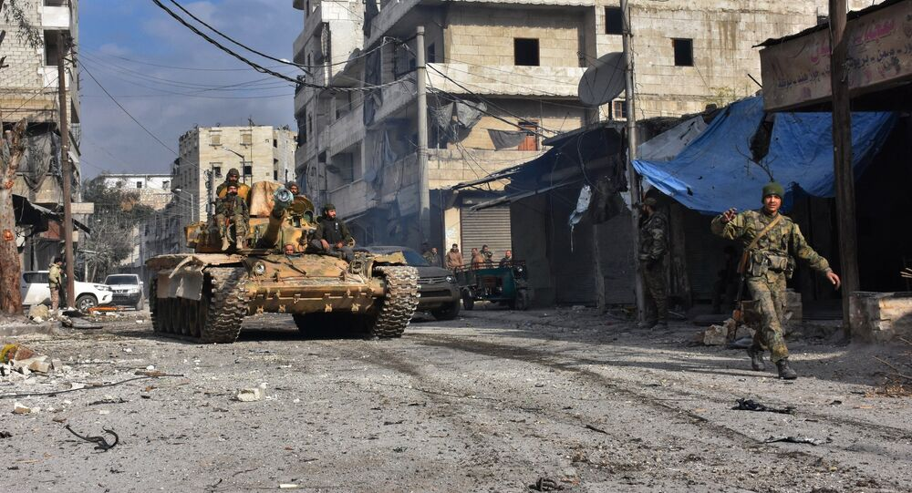Syrian pro-government forces patrol Aleppo's eastern al-Salihin neighbourhood on December 12, 2016 after troops retook the area from rebel fighters