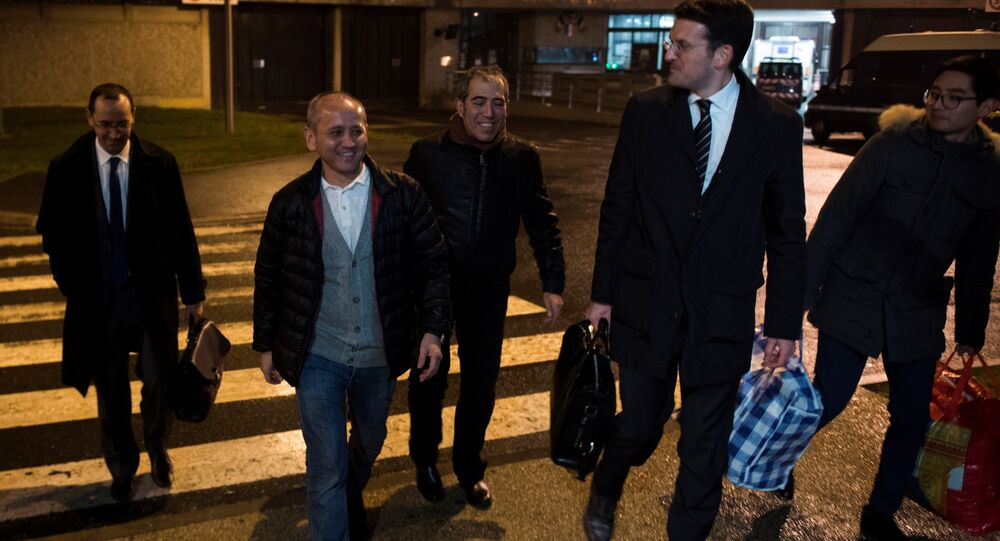 Kazakh opposition figure and oligarch Mukhtar Ablyazov (2nd L), flanked by his son Madiya (R) and his lawyers, reacts as he leaves the Fleury-Merogis jail after being released, on December 9, 2016, in Fleury-Merogis, near Paris