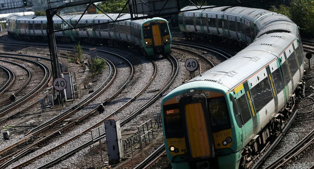 Southern Rail passenger trains arrive at Victoria Station in London on September 7, 2016