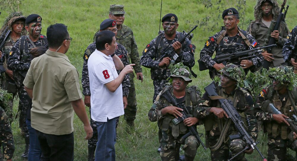 Philippine President Rodrigo Duterte talks to the Philippine Army Scout Rangers at their headquarters at Camp Tecson in San Miguel township, north of Manila,Sept. 15, 2016