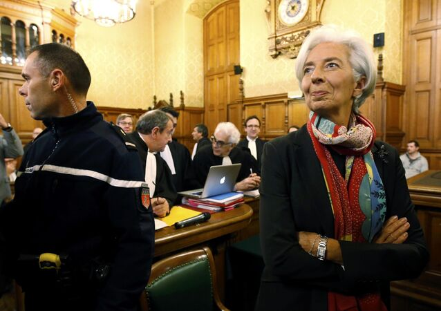 Managing Director of the International Monetary Fund (IMF) Christine Lagarde reacts before the start of her trial about a state payout in 2008 to a French businessman, at the courts in Paris, France, December 12, 2016
