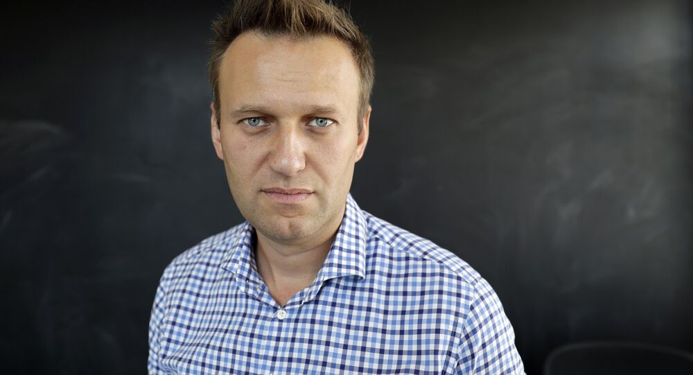 In this photo taken on 1 September 2016, Russian opposition activist Alexei Navalny speaks during an interview to the Associated Press in Moscow, Russia