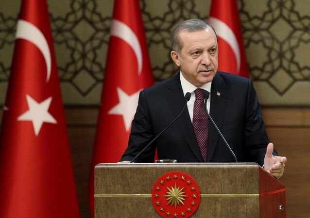 Turkish President Erdogan makes a speech during his meeting with mukhtars at the Presidential Palace in Ankara