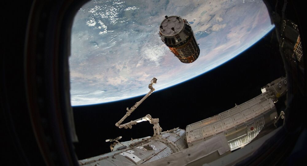 This photo provided by NASA TV shows a Japanese cargo ship before it arrives with Christmas gifts to the International Space Station on Tuesday, Dec. 13, 2016