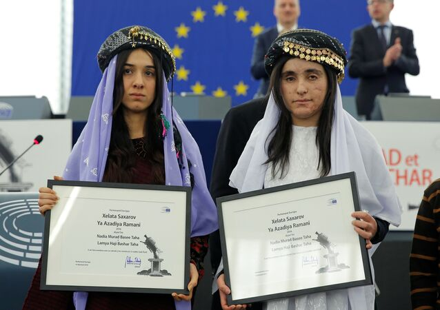 Nadia Murad Basee Taha (L) and Lamiya Aji Bashar, both Iraqi women of the Yazidi faith, pose with the 2016 Sakharov Prize during an award ceremony at the European Parliament in Strasbourg, France, December 13, 2016