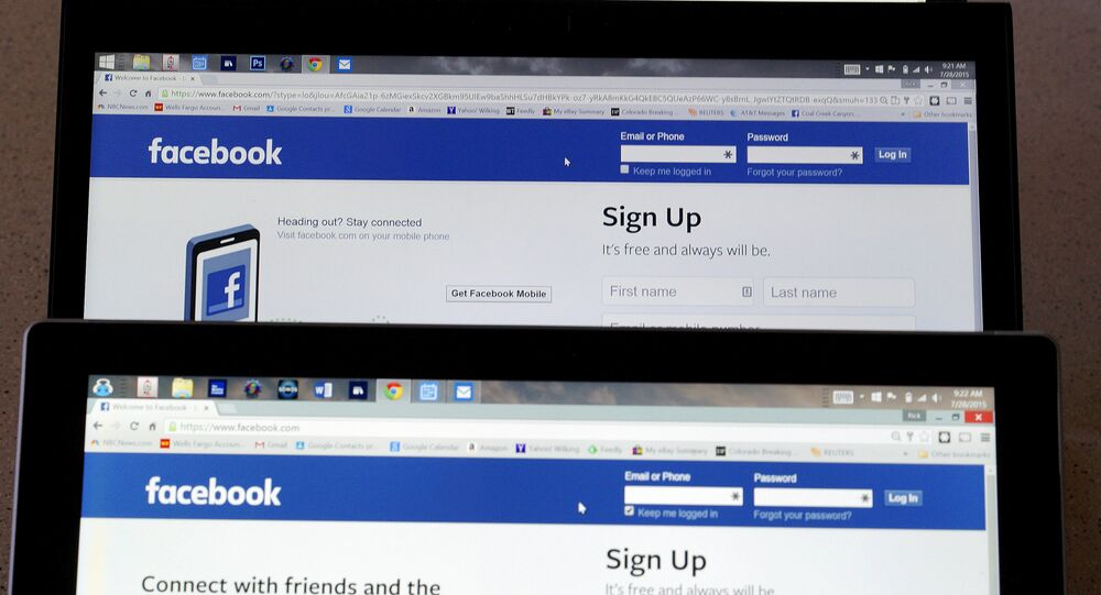 Computer screens display the Facebook sign-in screen in this photo illustration taken in Golden, Colorado, United States July 28, 2015