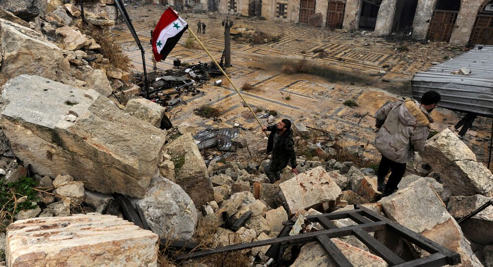 A member of forces loyal to Syria's President Bashar al-Assad attempts to erect the Syrian national flag inside the Umayyad mosque, in the government-controlled area of Aleppo, during a media tour, Syria December 13, 2016