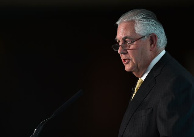 Chairman and CEO of US oil and gas corporation ExxonMobil, Rex Tillerson, speaks during the 2015 Oil and Money conference in central London on October 7, 2015