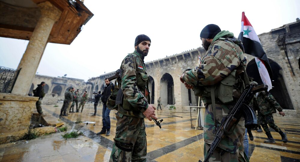 Forces loyal to Syria's President Bashar al-Assad stand inside the Umayyad mosque, in the government-controlled area of Aleppo, during a media tour, Syria December 13, 2016