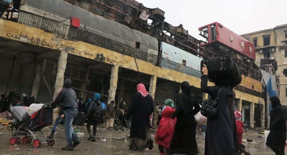 Refugees in the liberated district of eastern Aleppo