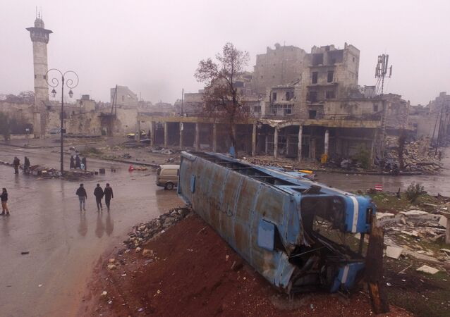 Residents in a liberated district in eastern Aleppo