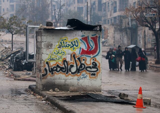 People carry their belongings as they flee deeper into the remaining rebel-held areas of Aleppo, Syria December 13, 2016