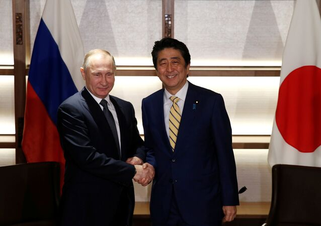 Russia's President Vladimir Putin (L) shakes hands with Japan's Prime Minister Shinzo Abe at the start of their summit meeting in Nagato, Yamaguchi prefecture, Japan, December 15, 2016.