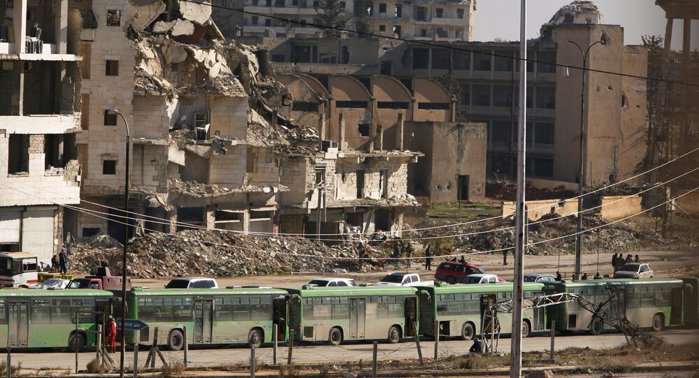 Buses are seen parked in Aleppo's government controlled area of Ramouseh, as they wait to evacuate civilians and rebels from eastern Aleppo, Syria December 15, 2016